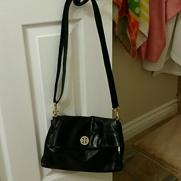 Tory Burch Dena Messenger Bag Leather Tan canvas interior 2 ways to carry (as seen in pics) Good used condition Top of bag and corners..leather is faded a bit (looks grayish) not noticeably unless close up  Description from Nordstrom Glossy, crackled leather with a supple, worn-in feel lends chic ease to a foldover crossbody bag finished with a monogram medallion and adjustable strap. Magnetic-snap closure. Optional, adjustable strap. Interior zip, wall and cell phone pockets. Logo-jacquard…