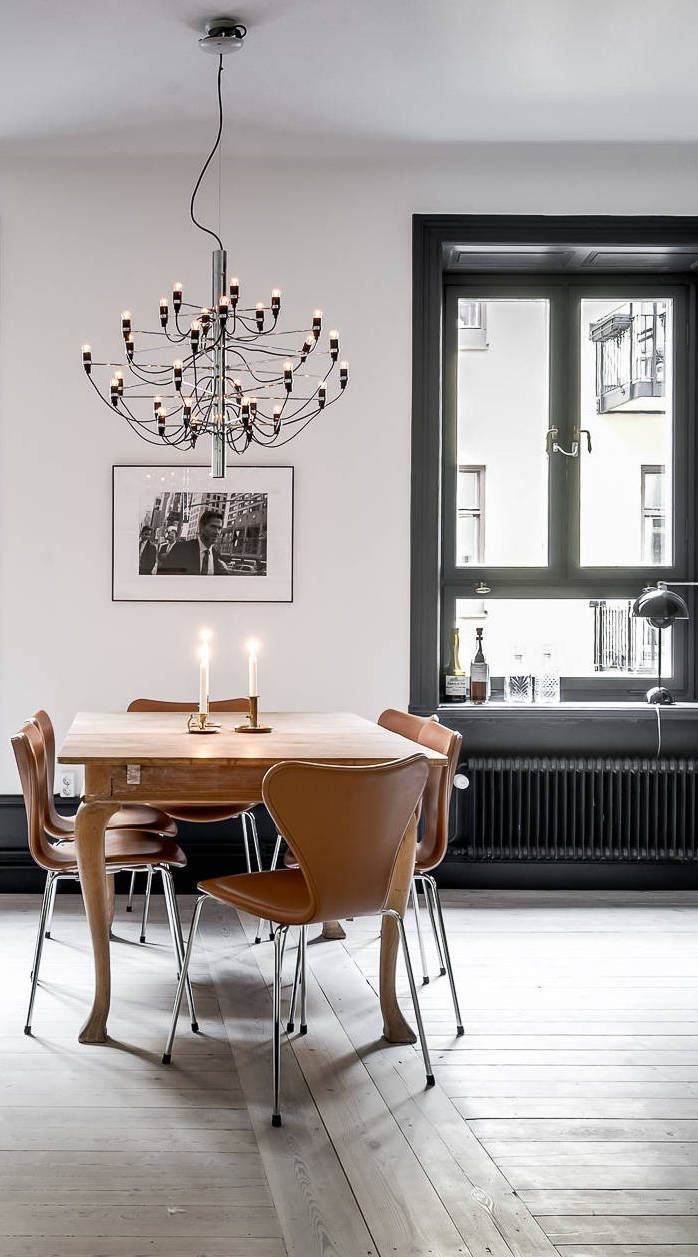 This dining room features an extra-high chair rail and two ...