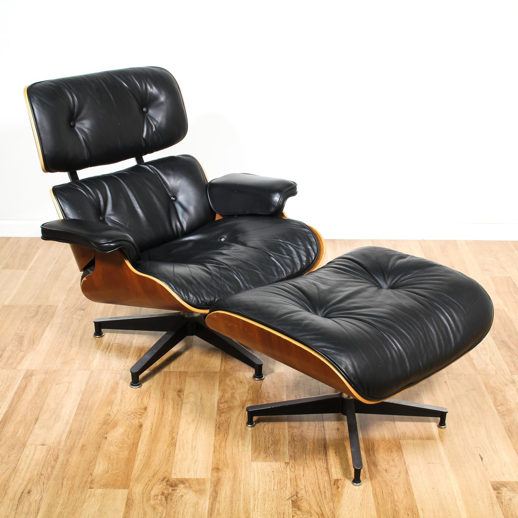 Eames for herman miller lounge chair eames for herman miller lounge chair and ottoman are upholstered in a durable shiny black leather