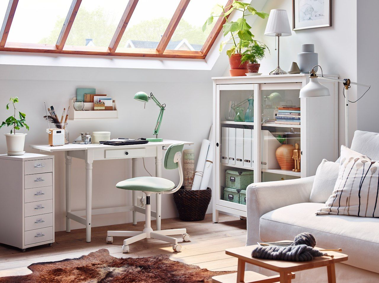 A traditional ingatorp desk in white in a sitting room with glass