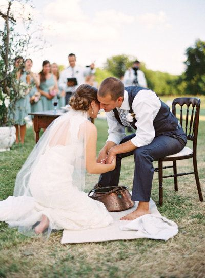 Washing each other's feet at their wedding as a sign of being servants to each other... beautiful