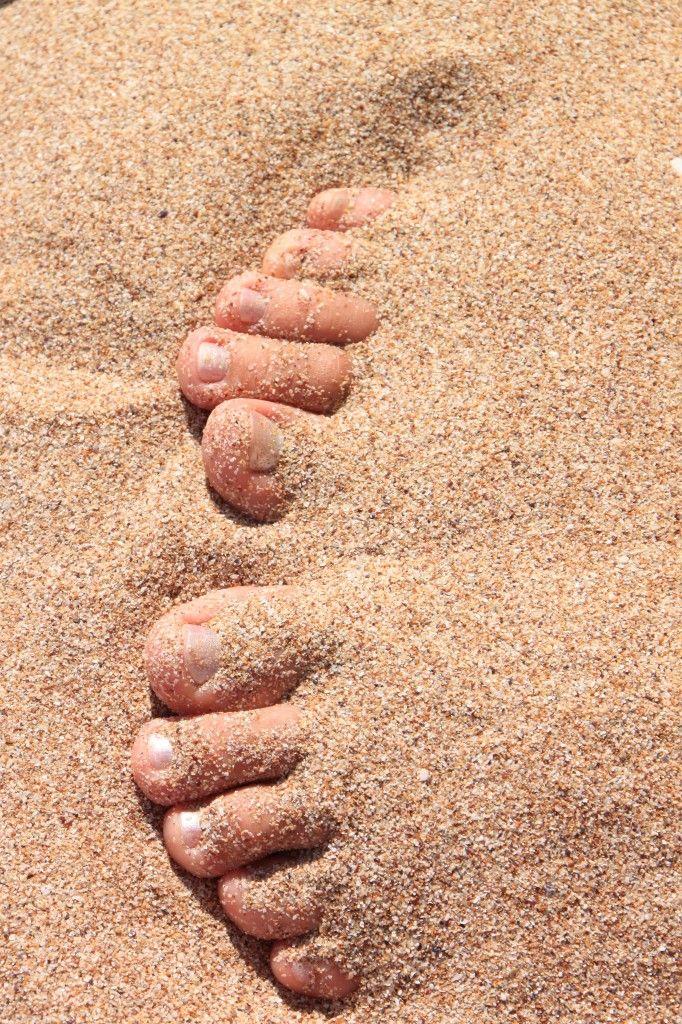 Woman Feet Covered With Sand On The Beach Public Domain Photos