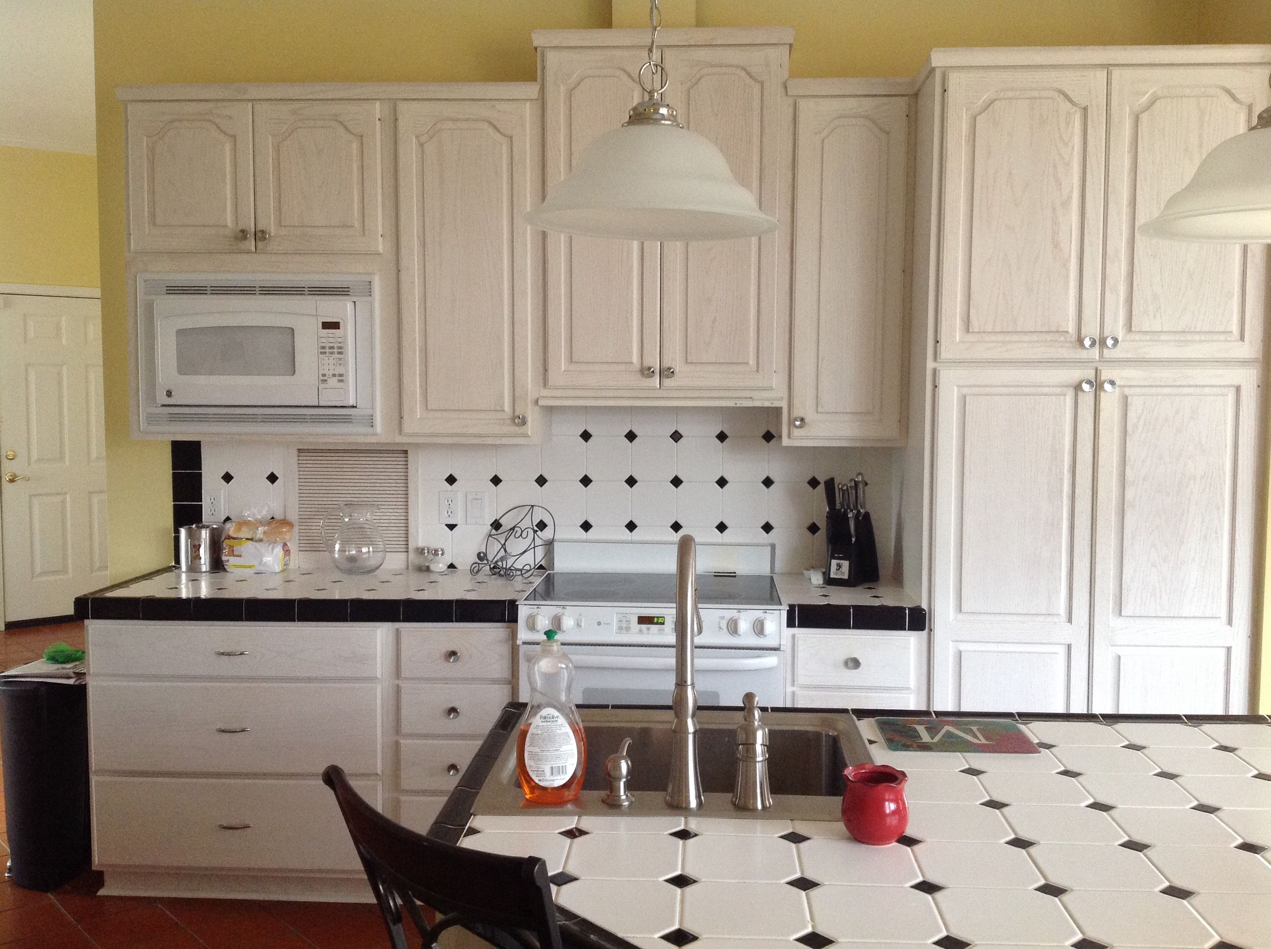 Current Kitchen White Black Tile And Whitewash Pecan Cabinets Vinyl Reddish Floor Yellow Walls Kitchen Cabinet Design Kitchen Design White Kitchen Cabinets
