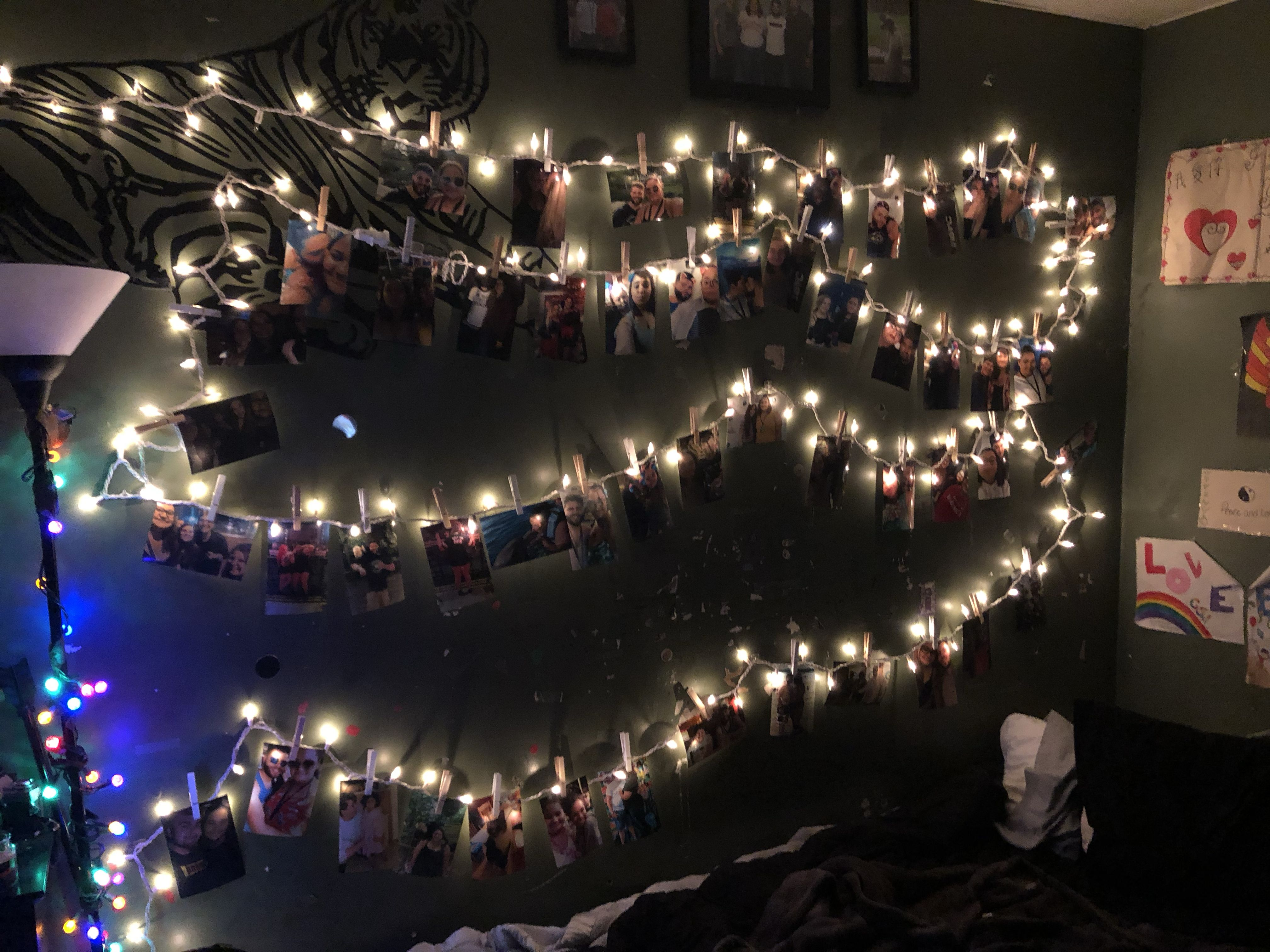 Some simple Christmas lights, precious photos, clothes pins, and 3m command light hooks turn a ...