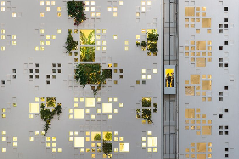 greenery emerges through jean nouvel's pixelated 'white walls' tower in cyprus