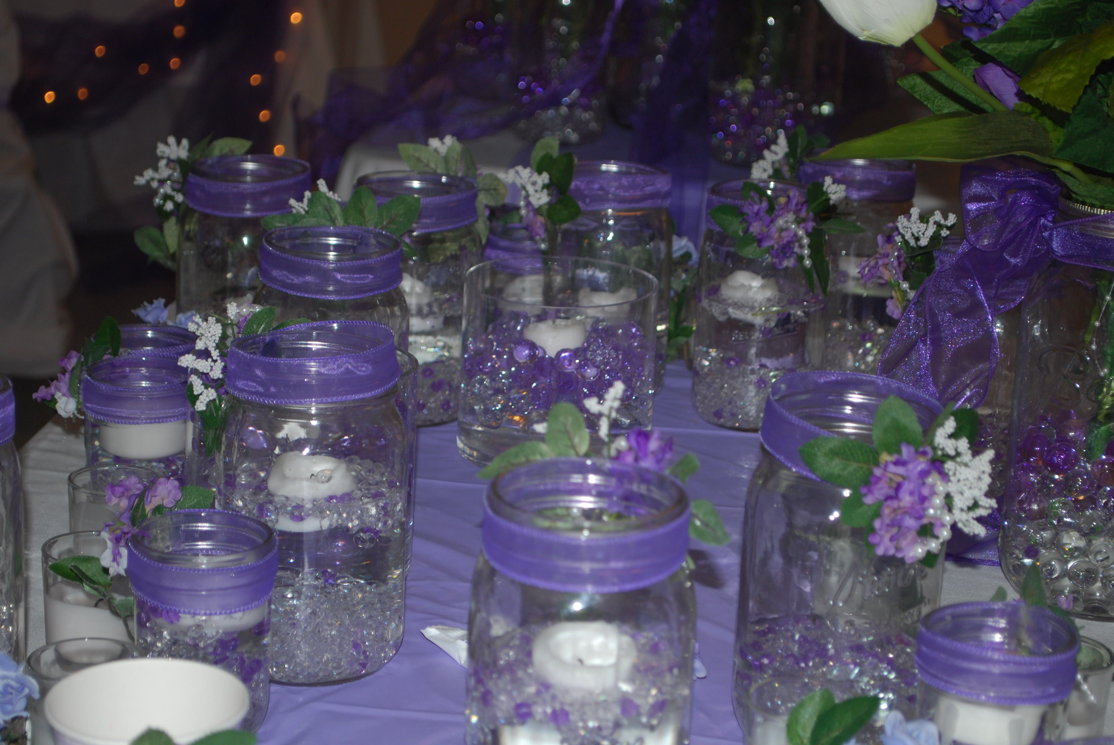 Mason jars filled with water beads floating candles and