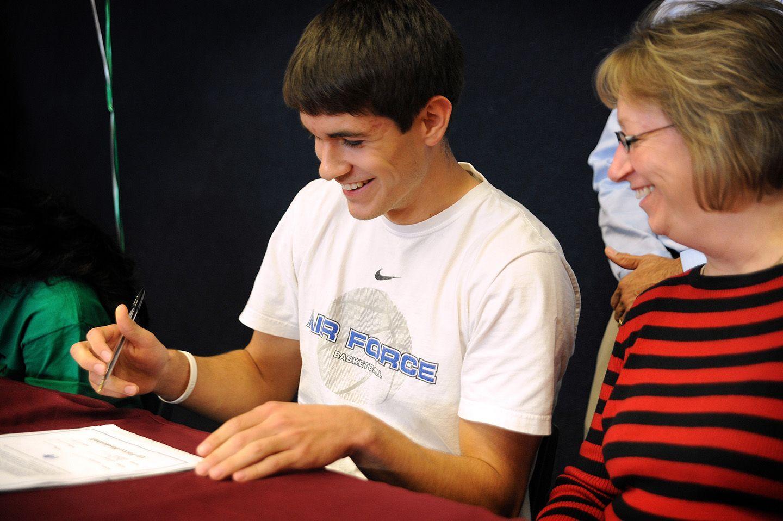 Twelfth grader Dylan Clark, 17, signs a letter of intent