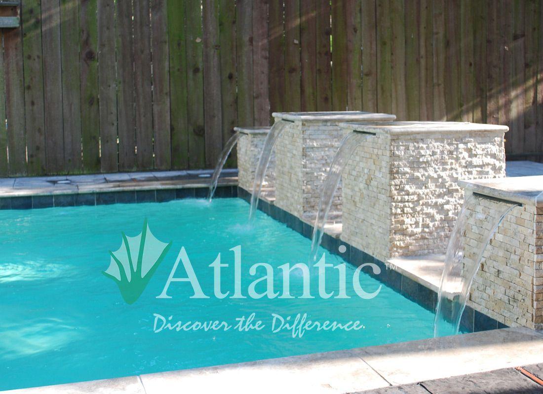 Atlantic Pool colorfalls installation in a swimming pool atlantic water gardens