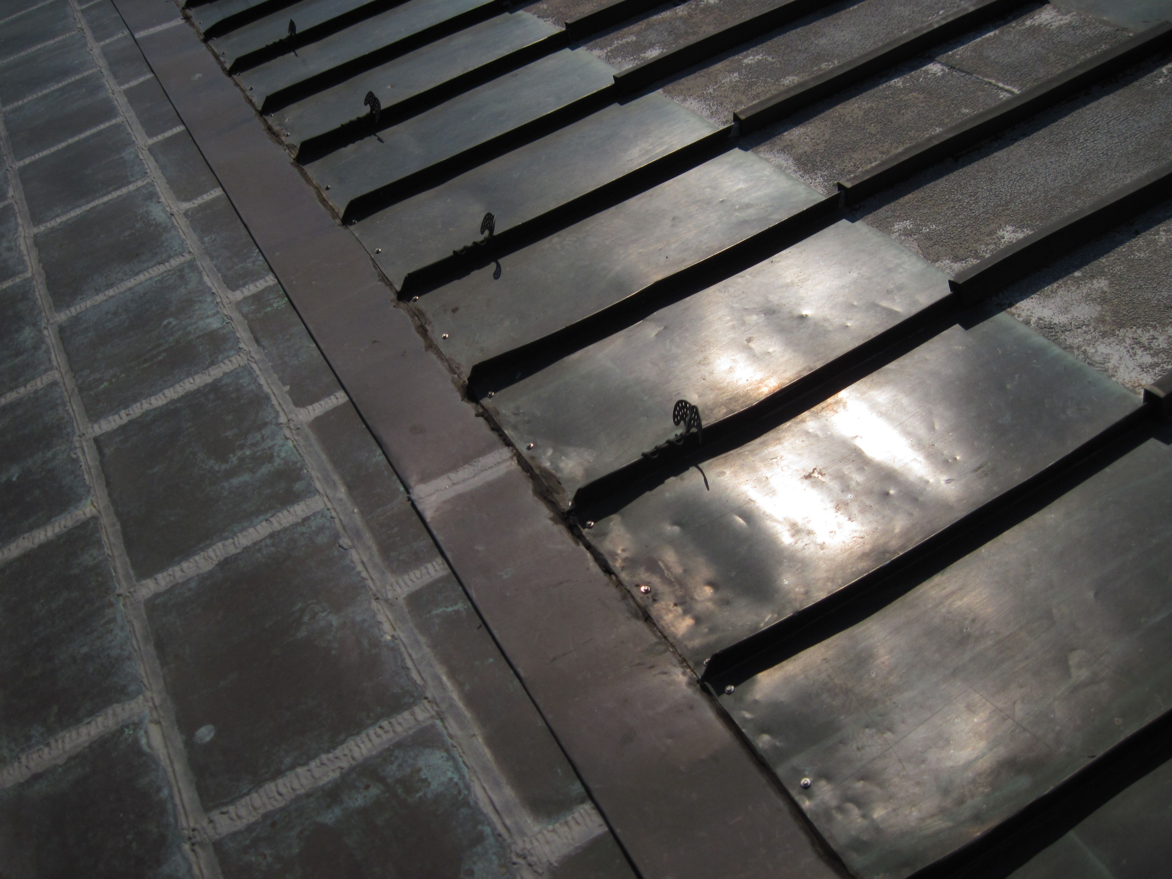 Solutions For Copper Roofs Lapping Cleats That Allow Sheets To Slide Standing Seam Right Or Small Sheet Sections Flat Sea Copper Roof Standing Seam Copper
