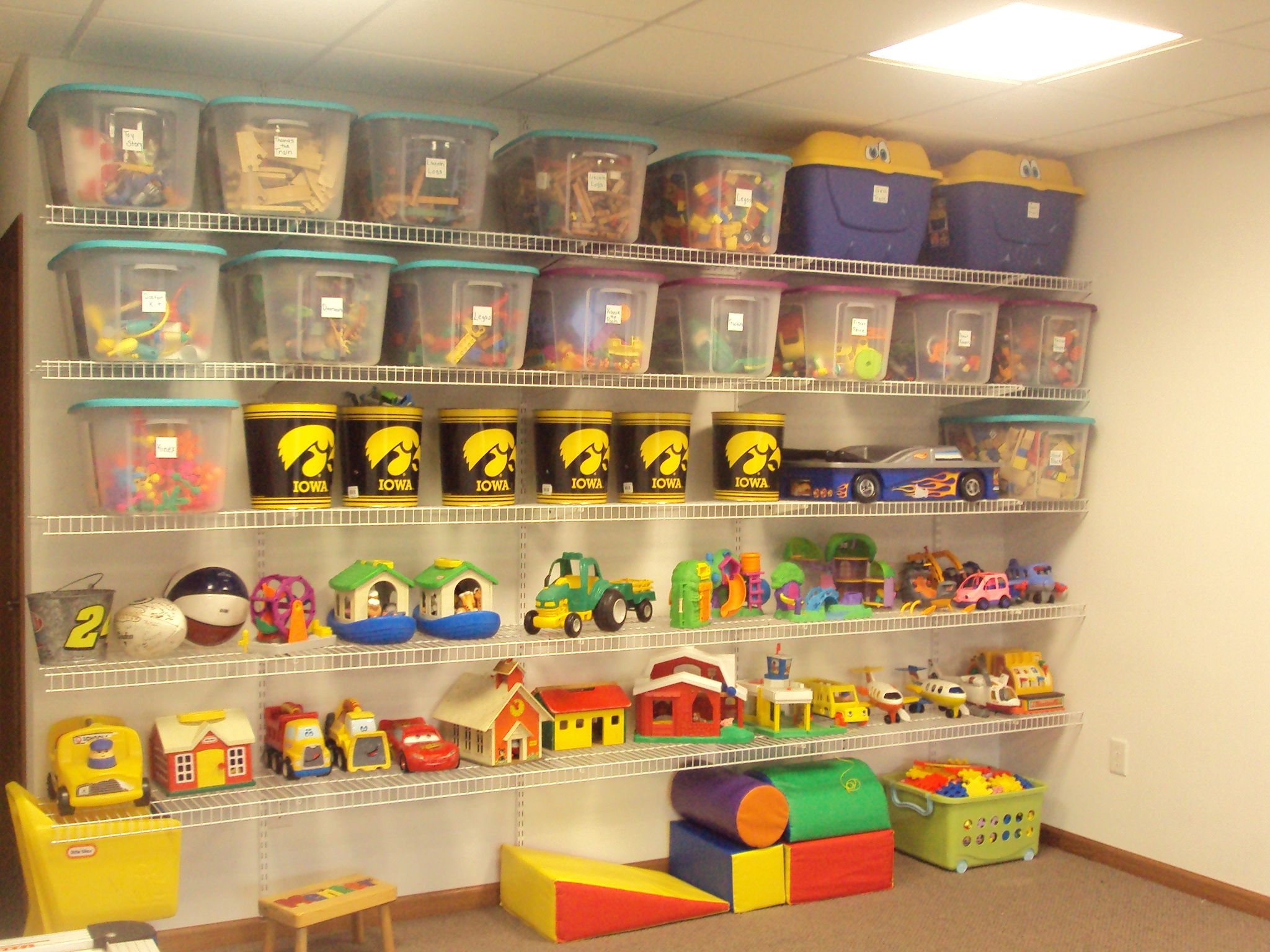 A organized playroom. Wire shelving from Lowes, some totes with ...