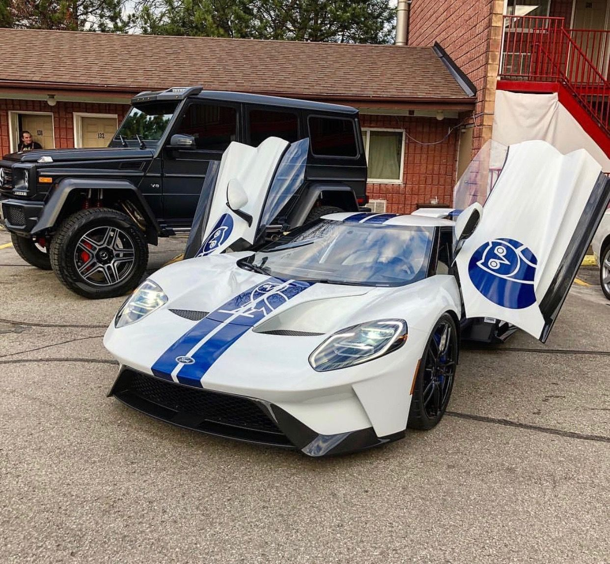 Ford Gt Painted In White W Blue Racing Stripes With The Ovo Owl Logo In The Center And Two More Ovo Owl Logos Under The Side View Mirrors And A