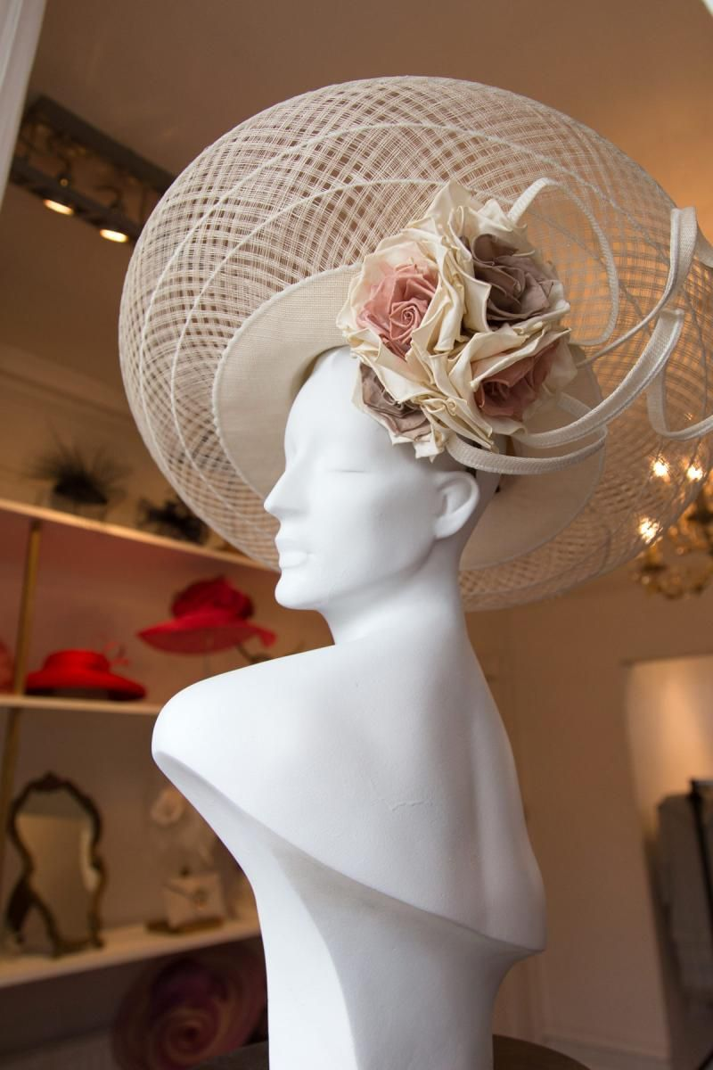 e3eb8f85 Large disc hat with pink, cream and mocha roses underneath with sinamay  twists