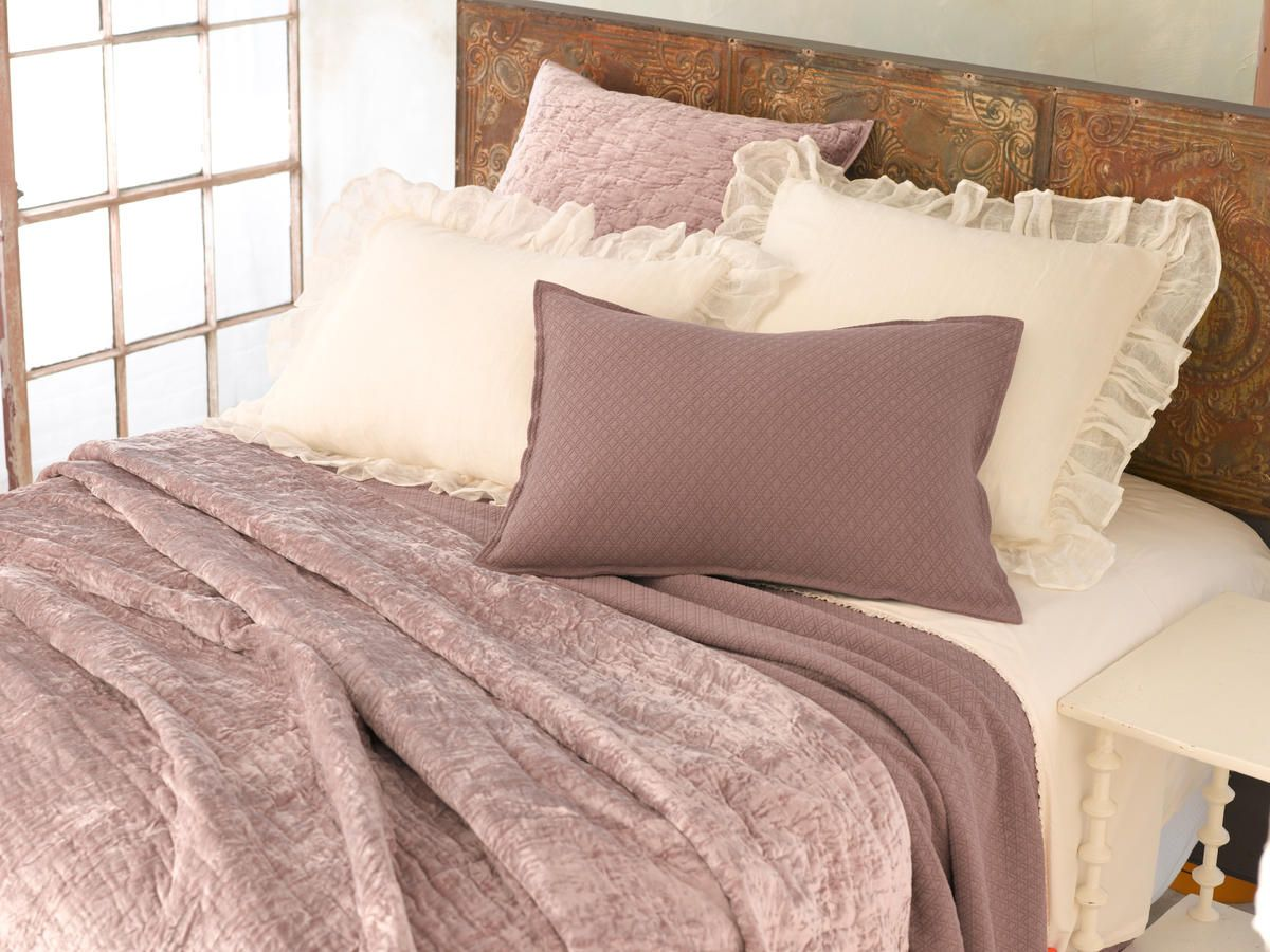 casual comfort and richness redefined does it get any better than a cozy velvet quilt textured matelass ruffled sheets and gauzy linen shams