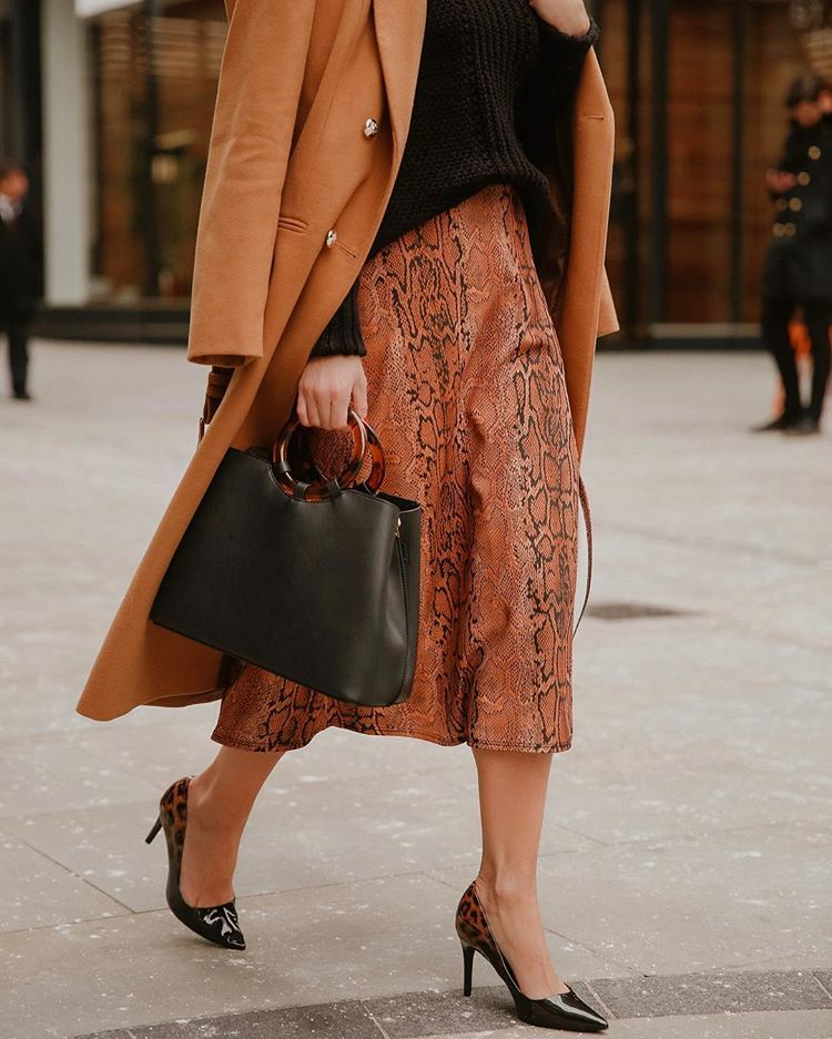 74516515c8c3 She Goes wear with a black and burnt orange outfit with animal print details