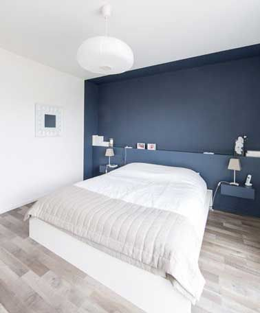 Paint a wall in dark blue to enhance your bedroom decor - art
