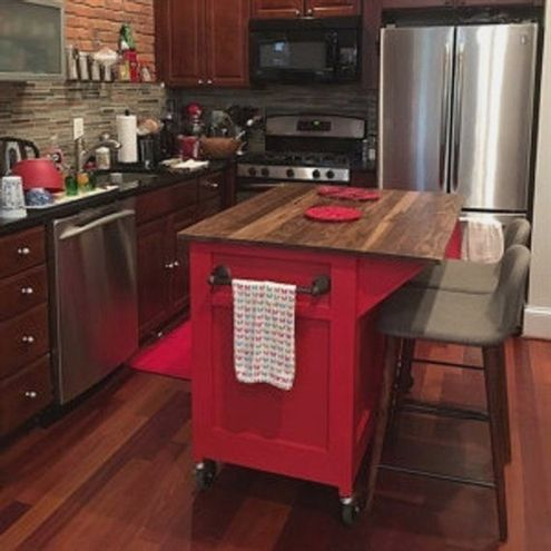This Rolling Kitchen Island packs in the features to make food prep
