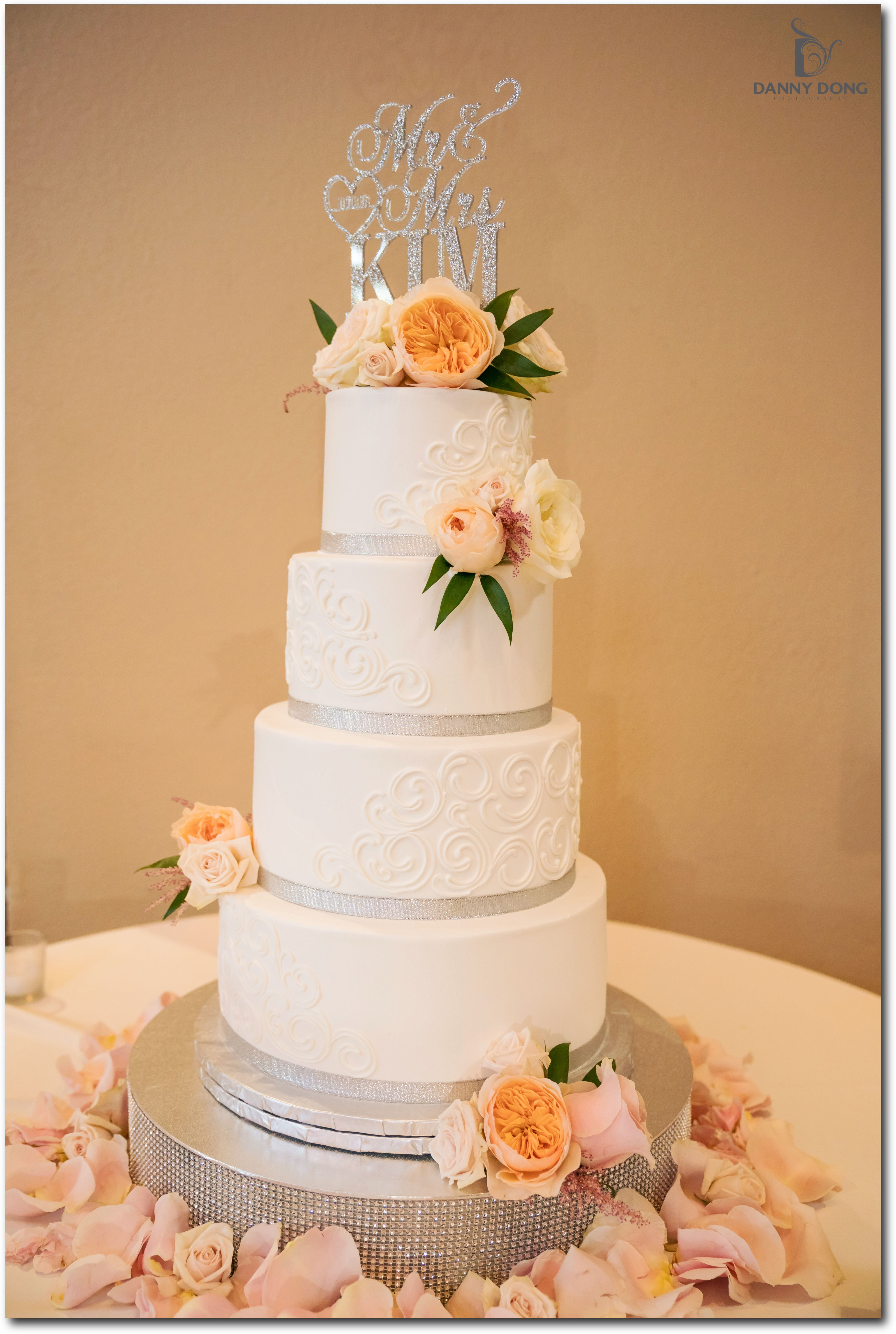 Gorgeous Wedding Cake By Gala Bakery Topped With Fresh Roses And