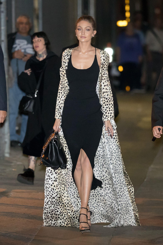 d6a01fa9cb54 In a black Nanushka slip dress, Stuart Weitzman sandals, a black handbag  and cheetah print silk robe while out in New York City.