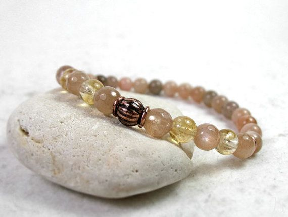 Beautiful Good Fortune & Prosperity stone bracelet. Sacral & Solar Plexus Chakra bracelet. November birthstone. Sunstone & Citrine gemstone bracelet.  This natural gemstone bracelet is the essence of organic elegance and will match effortlessly with practically any outfit. It looks beautiful worn alone, but is sensational for layering and stacking with other bracelets.  Made with natural A+ grade Sunstone, filled with warm, golden glitter, and A grade natural semi-precious Citrin...
