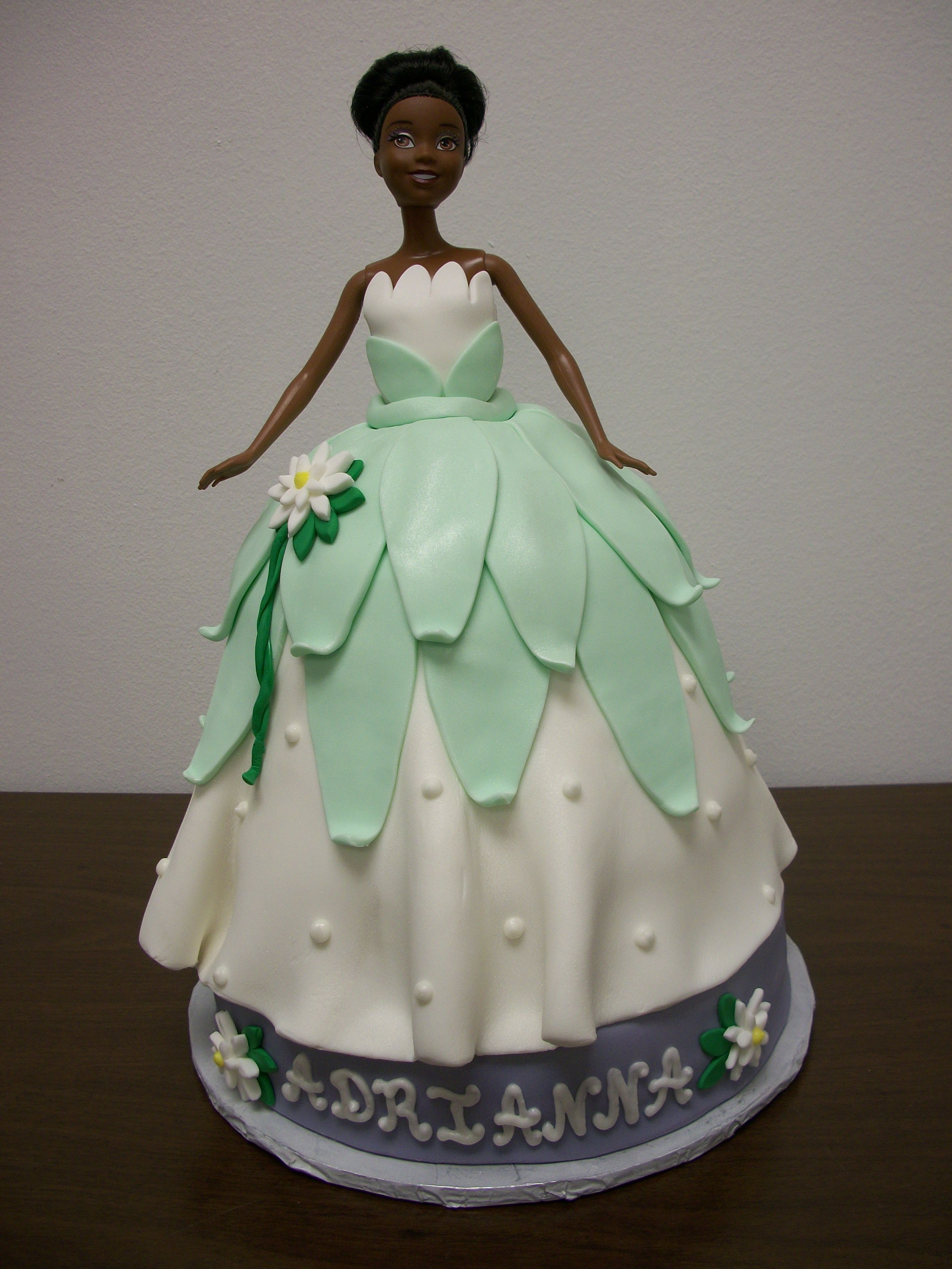 Cake using a princess tiana doll for my friends daughter