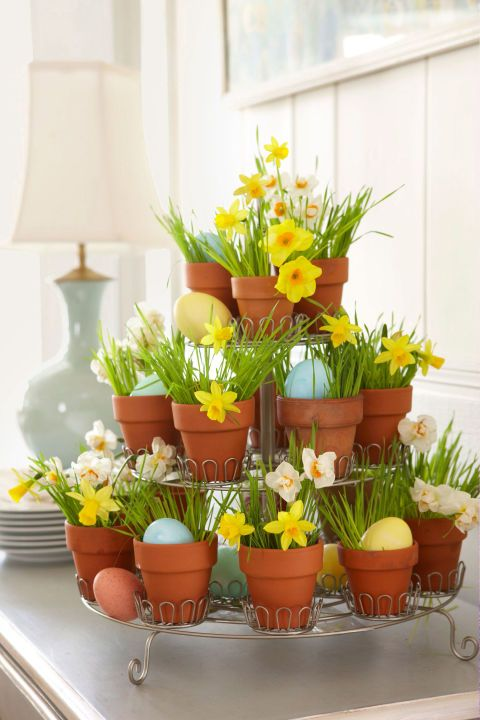 A mini-cupcake holder rises to the occasion when it's repurposed as a seasonal accent. Just insert pint-size pots plus blades of wheatgrass from a health-food store, alternating daffodils with dyed eggs.