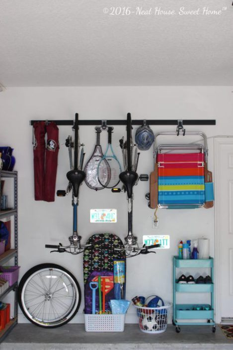 Using Vertical Storage in Garage Walls - Home Organization ... on how can i hang my garage shelving, clean your garage, wooden workbench kits for garage, cleaning out your garage, space organizing your garage, organize my garage,