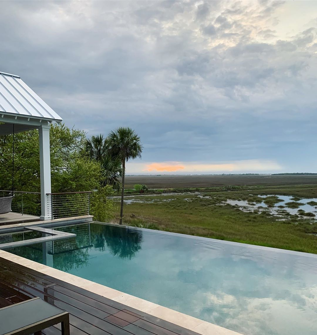 """The_Exchange_Co's Instagram profile post: """"Here's a view we could get used to! #theexchangeco #backyardrenovation #lovewhereyoulive #charlestonrealestate #infinitypool #charlestonsc…"""""""