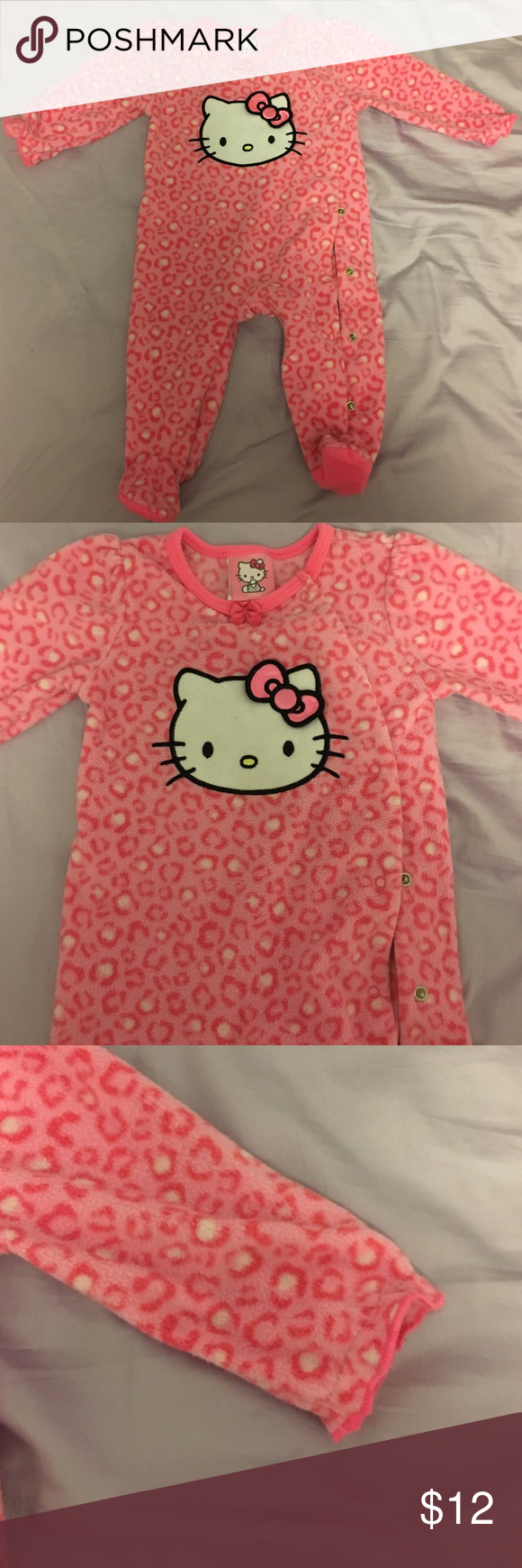 Pink Hello Kitty sleeper Hello Kitty fleece sleeper for baby girl. Used but super cute and very warm. Buttons on the side. Hello Kitty Pajamas