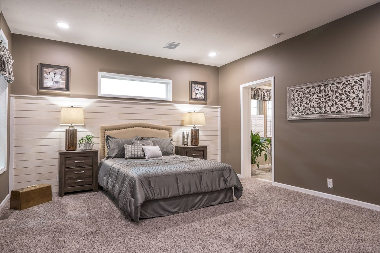 Master bedroom with shiplap wall accent from Champion ...
