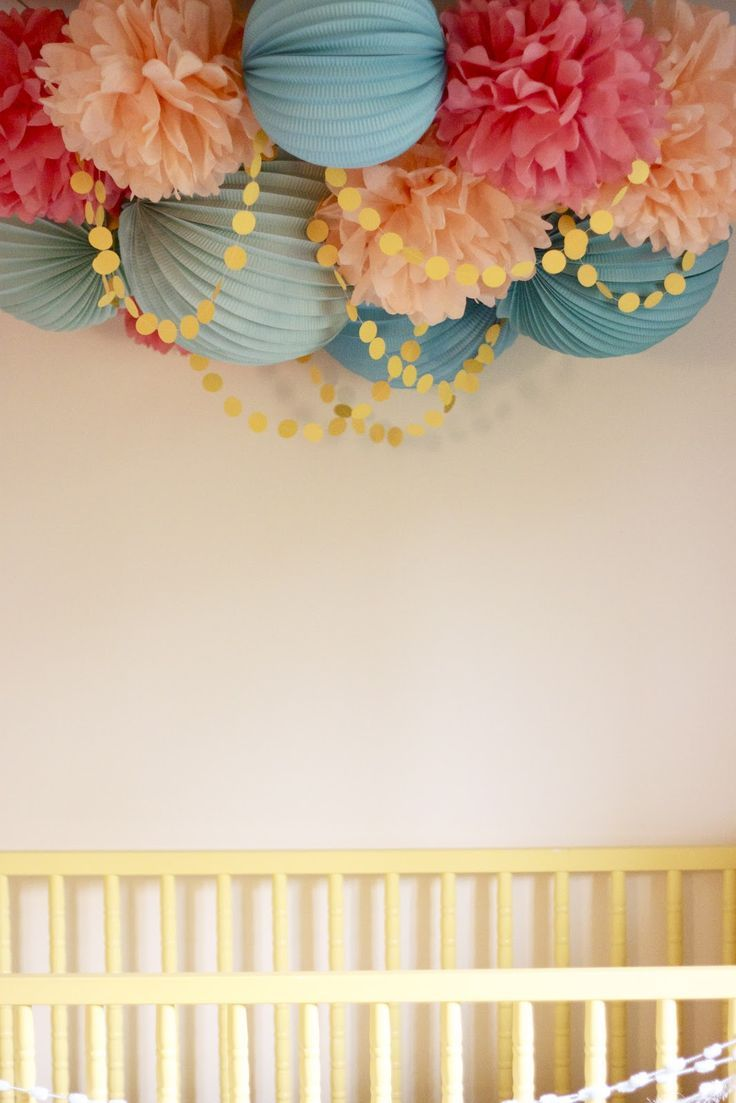 Loving this cluster of pom poms and paper lanterns. Such a fun color mix.