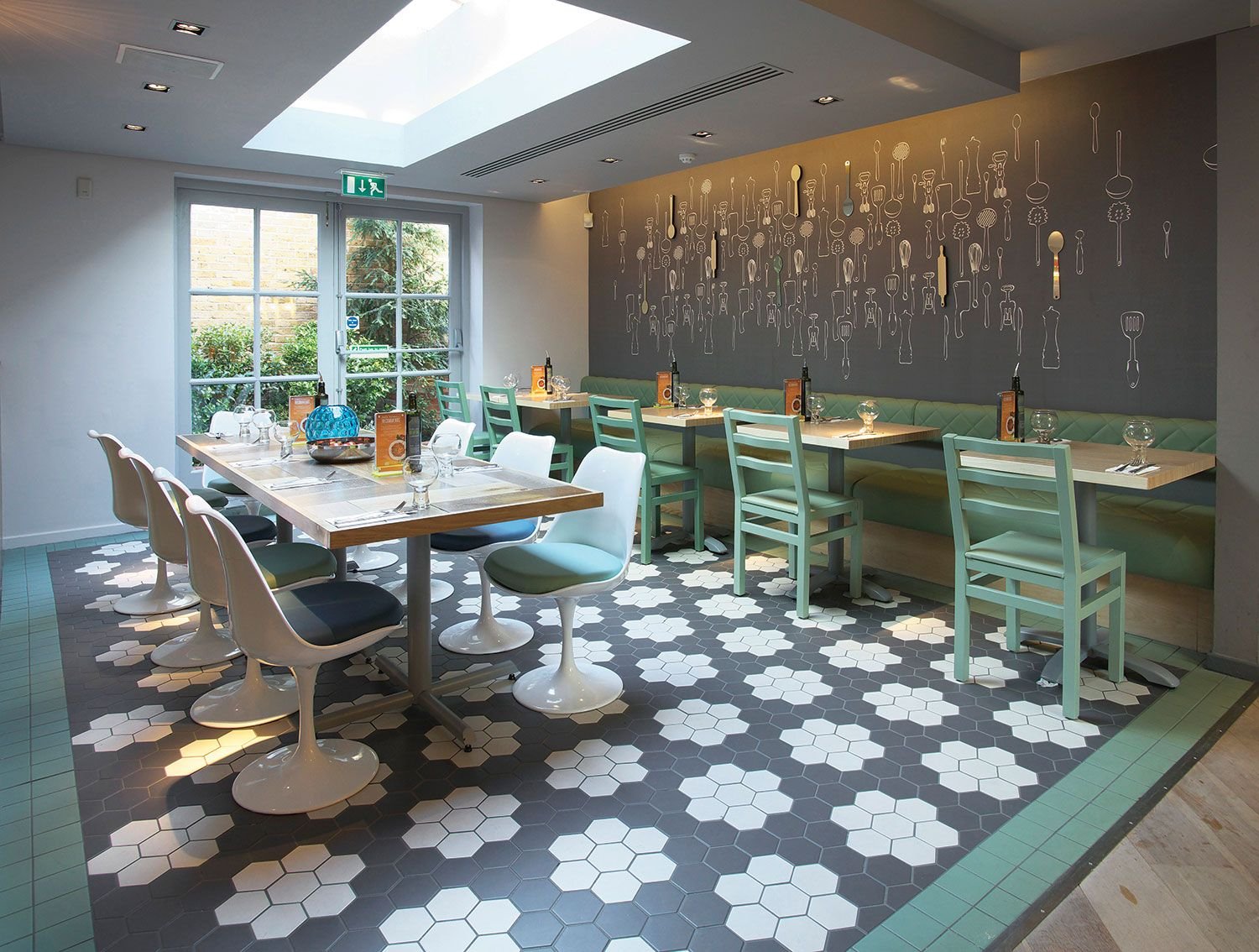 A funky and trendy restaurant design featuring hexagon tiles from ...