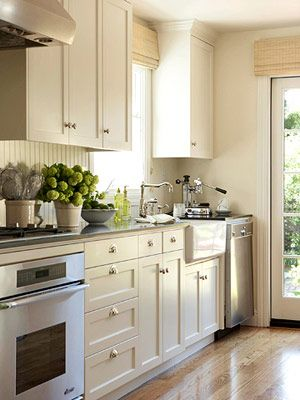 Classic, simple, lime green accents, farmhouse sink and bead board backsplash.