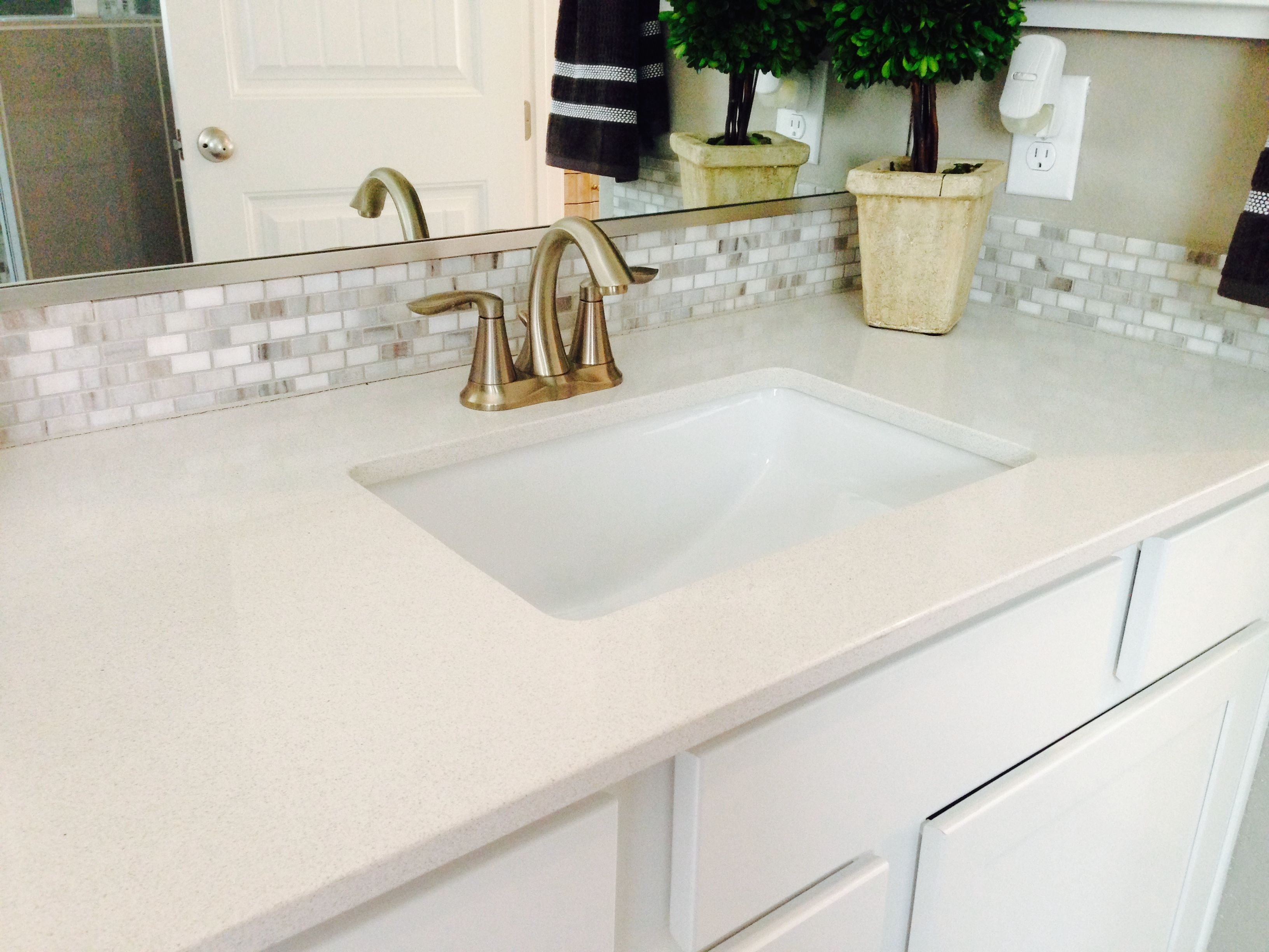 Master bath vanity silestone counter with decorative mosaic tile master bath vanity silestone counter with decorative mosaic tile backsplash and undermount white trench bowl sink dailygadgetfo Images