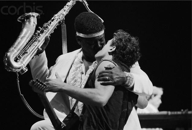 Bruce Springsteen and Clarence Clemons sharing a kiss