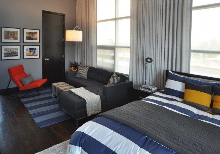 Simple Studio Apartment Bachelor Pad With Strip Decoration And Orange Otoman Chair Furniture Photorika