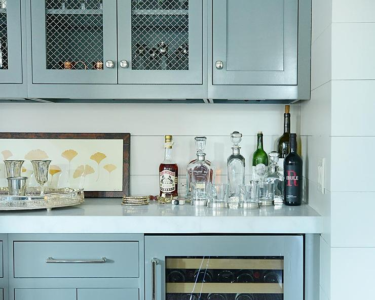 Beautiful living room bar features gray cabinets fitted ...
