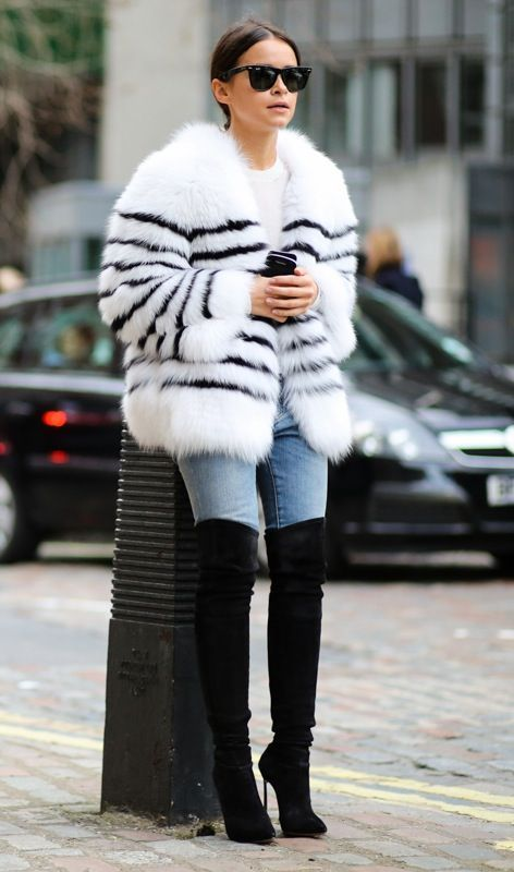 Miroslava Duma // wayfarer sunglasses, striped fur coat, skinny jeans and over-the-knee boots More faux fur outfit inspiration on www.LiveLifeWellBlog.com
