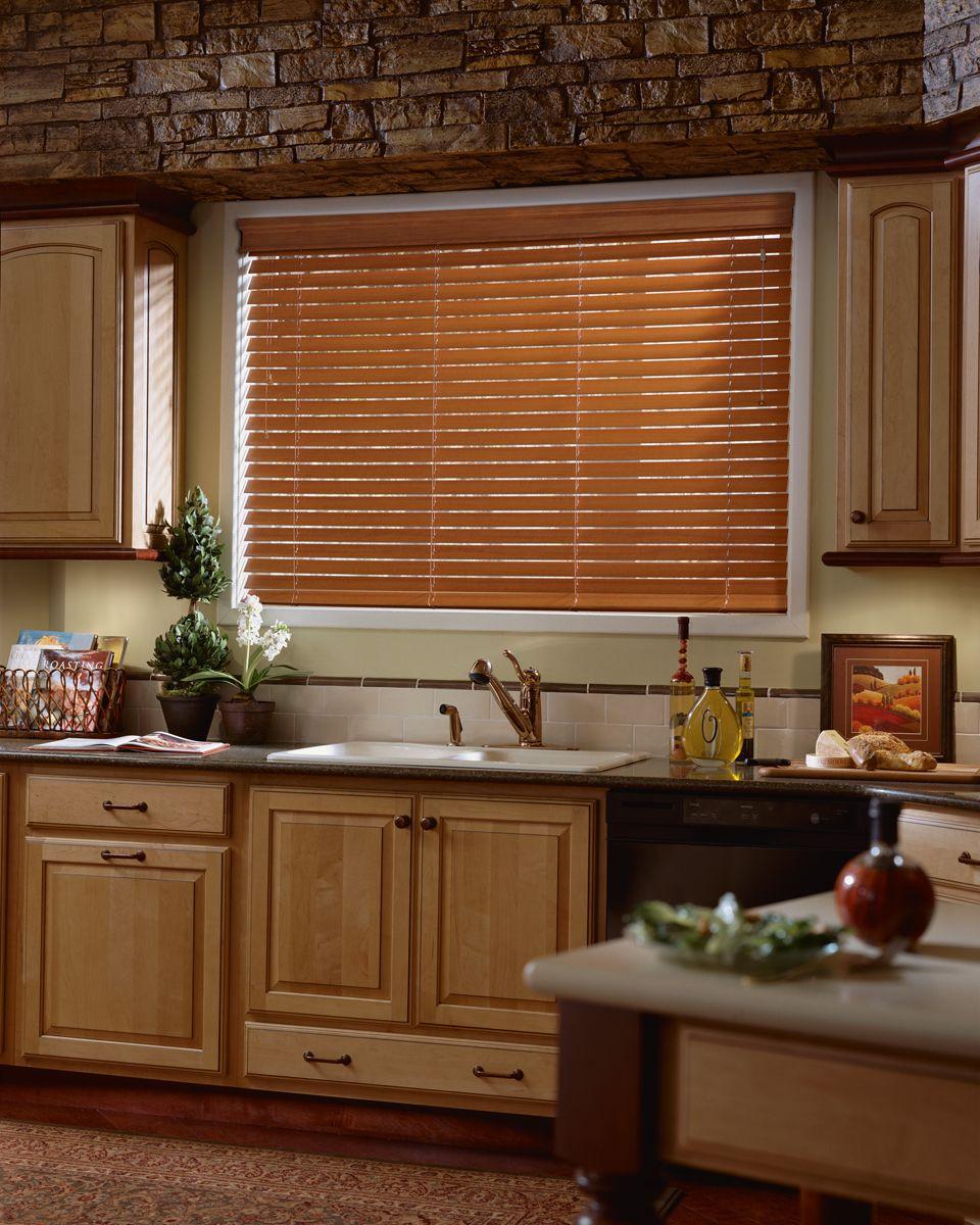 Horizontal wood blinds in kitchen. Venetian blinds. Kitchen window ...