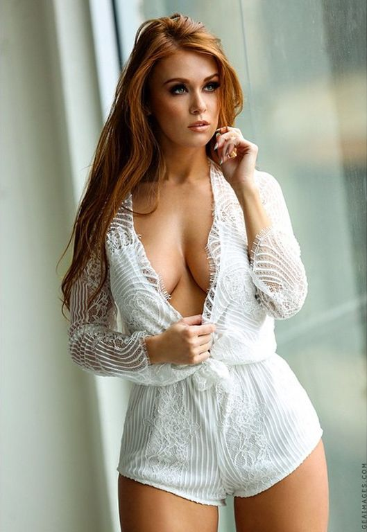 Hot ginger girl teasing herself with pleasure 2