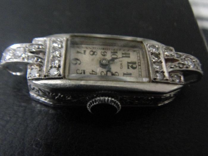 """IWO dames platina omhuld diamant bezaaid Bezel polshorloge origineel gemarkeerd bellen gemarkeerde verkeer  Vintage en zeldzame de platina omhuld dames horloge door IWO gestart door Jacques Wollmann in Biel Schweiz (Zwitserland) dit is een groot horloge met 24 diamanten instellen op de top van het geval. Geval is terug een stempel """"Platine Garanti"""" (betekenis """"Gegarandeerd Platinum""""). Maat 11 mm  22 mm ongeveer en grootte met schaal sommige nul fout mogelijk genomen. Afbeelding gekoppeld.Dit…"""