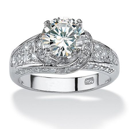 Take Your Breath Away Beauty The Twisted Setting Showcases The Round Cubic Round Engagement Rings Engagement Rings Platinum Sterling Silver Engagement Rings