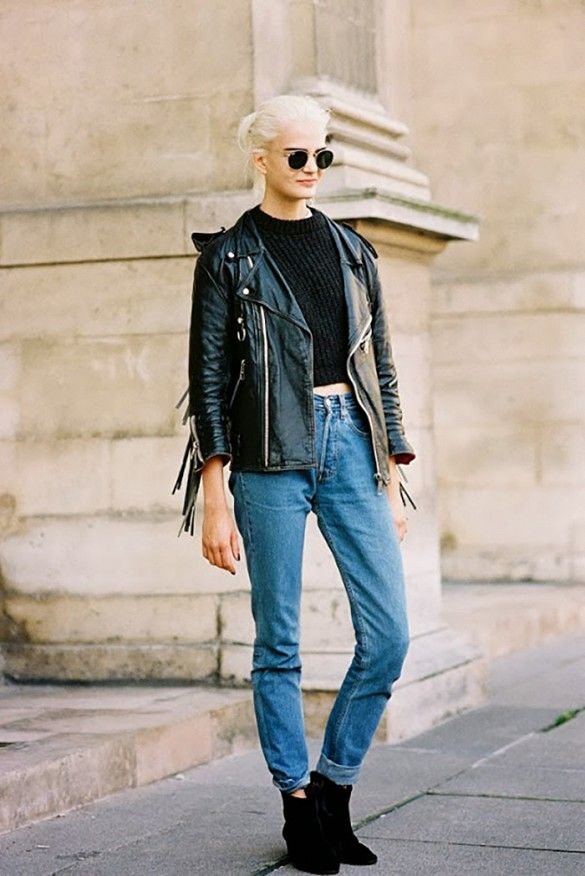 Black leather jacket with fringe paired with black ankle boots