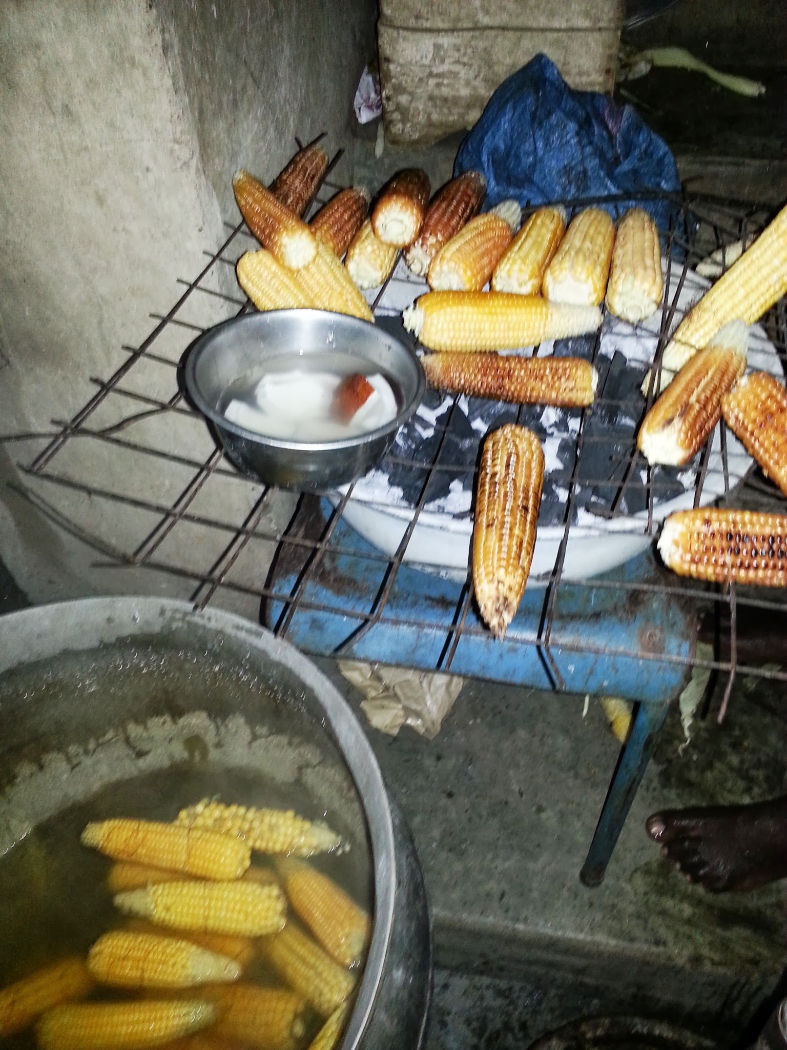 Roasted corn and boiled corn is a common snack in Nigeria that goes well with soaked coconuts--KOO