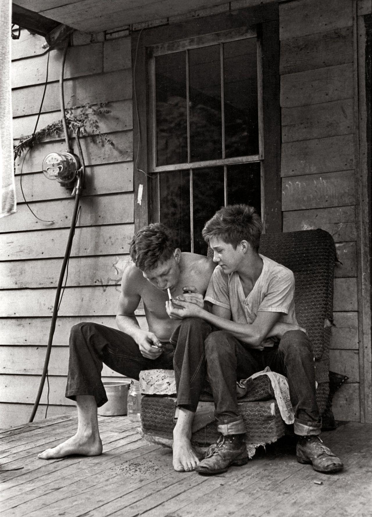"paws44: jonestownscoundrel: Cheers mate. William Gedney; Leatherwood, Kentucky, 1964. ""Cornett boys sitting on porch lighting cigarette."""