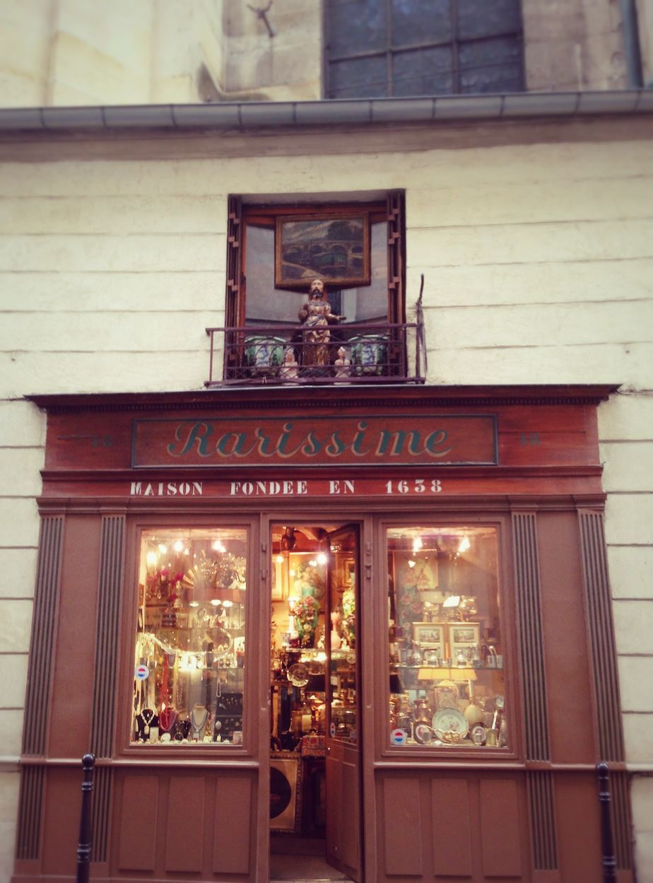 The Tiniest Antique Shop In Paris Is Stuck To The Side Of A Church And Sells Fresh Eggs Antique Shops Paris Shopping Antiques