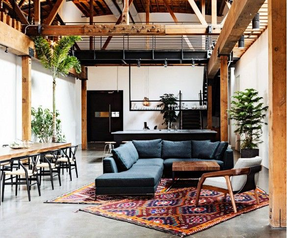 Shop the Room: Modern Loft Living // Rich, layered rugs and plants make this cool industrial space feel cozy and inviting.
