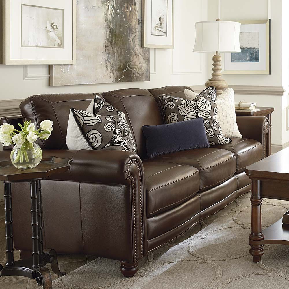Unique Motive Cushion Combined With Fashionable Rug And Frosted Glass Brown Couch Living Room Leather Living