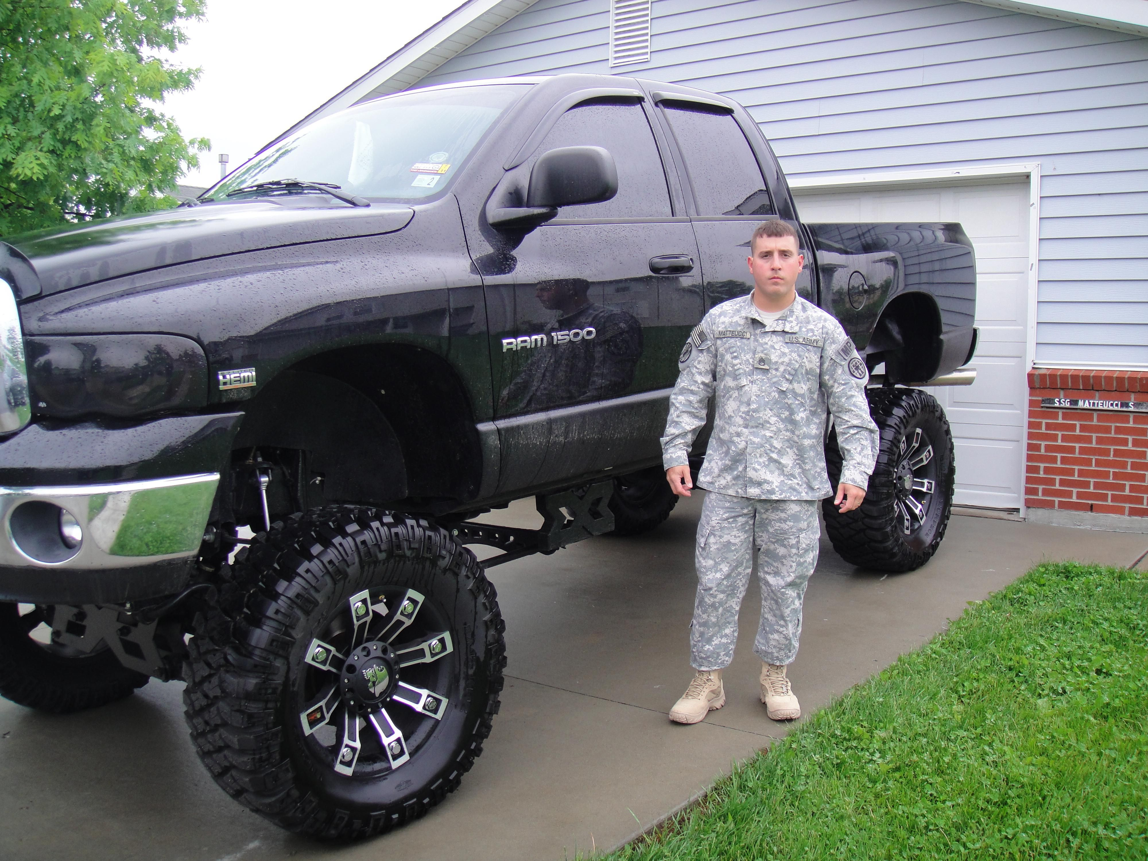 proud owner of highly lifted black dodge ram truck | Dodge Ram,Chevy