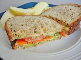 whole wheat with hummus, avocado, tomatoes, carrots and cucumber