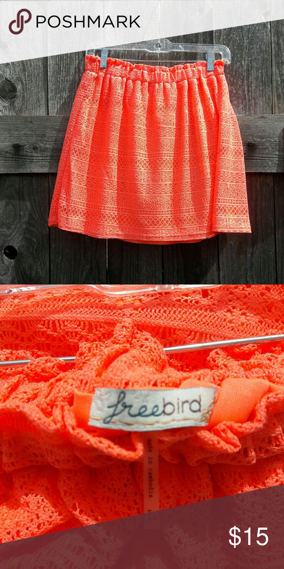 """Price Drop! Neon Orange Summer Knee Length Skirt Fun summer skirt. Knee length. Lace overlay. Roomy elastic waist. Lined. Bright neon color! Freebird brand. Size """"L""""  Length: 17""""  **This item is not new, but gently used. These items have been in a smoke free home, with pets. All reasonable offers are considered. Please ask any & all questions before buying!! Freebird Skirts Mini"""